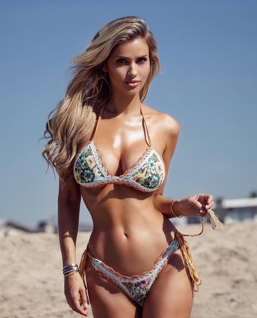 hot blonde babe wearing swim suits in beach
