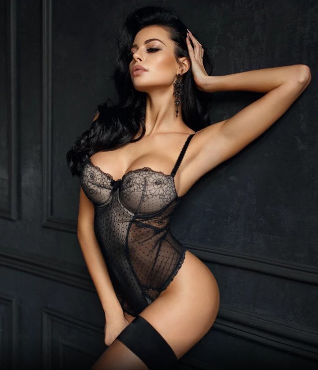 hot babe wearing black luxury lingerie